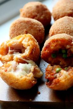 Arancini- fried balls of risotto filled with cheese/pancetta/peas/etc. In the south of Italy arancini are made with tomato risotto, and filled with saucy peas, soft provolone, and pancetta a rosto (ham).