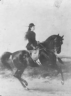 Queen Wilhelmina of the Netherlands on horseback.
