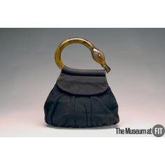 "Suede bag with acrylic ""flamingo"" handle from Bergdorf Goodman, c.1938, USA, Gift of Betti H. Salzman. Collection of The Museum at FIT"