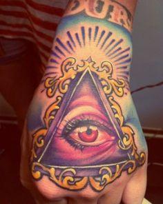 All Seeing Eye Tattoo On Hand Coloured all seeing eye of illuminati . Hand Tattoos, Dreieckiges Tattoos, Weird Tattoos, Finger Tattoos, Love Tattoos, Body Art Tattoos, Tattoos For Guys, Color Tattoos, Wicked Tattoos