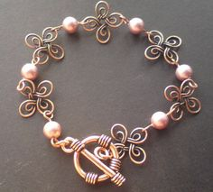 I would switch out the flowers with wire hearts and use red beads to make a cute Valentine's Day bracelet