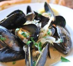 Steamed Mussels in White Wine Broth...serve with warm baguette to mop up the juices...