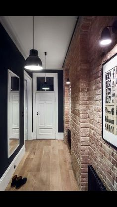Masculine entryway with exposed brick walls and dark hues. Loft Interior, Brick Interior, Home Interior Design, Brick Accent Walls, Exposed Brick Walls, Flur Design, Hall Design, Design Design, Hallway Designs