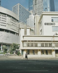 Tunjungan Plaza, Seiko Building and a Photographer