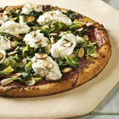 Pizza with wilted greens, ricotta cheese, and almonds