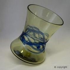 "Viking Wobble Glass ""Replica Viking Age hand blown wobble glass, featuring a unique shape that allows the glass to ""wobble"" on its base. The glass is either patterned with blue decoration or is plain. Blue Wobble Glass (illus)"""