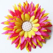 This flower is absolutely adorable!! This precious designer daisy has layers of yellow and hot pink petals. Lovely little fabric polka dot button was added to the center. This little flower will be a great addition to any hair collection. Available with or with out a clip.  $1.99 at Wholesaleprincess.com