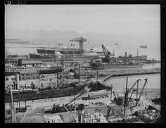 Newport News, Virginia. General view of the fitting and repair slips at Newport News, Virginia. The S.S. America can be seen in the background. The ship in the adjacent slip is a tanker