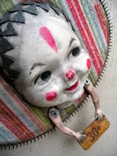 Can I make something like this into a Doorknocker for when my sister comes to visit? She'll freak out, then she'll laugh (bad scary movie experience when we were kids, involving killer dolls).   I could find the doll head and arms at a thrift store... Not sure what to use as a backing.  A round tray maybe?