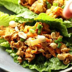 Simple and so flavorful, these Thai turkey lettuce wraps have a tangy and slightly spicy peanut sauce. Spoon the filling into crisp romaine lettuce leaves for an easy and lower in carbs dinner option. #sweetpeasandsaffron #lowcarb #video Healthy Turkey Recipes, Best Lunch Recipes, Ground Turkey Recipes, Dinner Recipes, Amazing Recipes, Summer Recipes, Ground Turkey Lettuce Wraps, Easy Lettuce Wraps, Lettuce Wrap Recipes