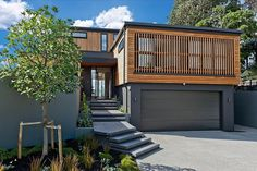 Looking for concrete stairs design and trends? Access a gallery of concrete staircase photos from top outdoor designers. Cedar Cladding, Exterior Cladding, Concrete Staircase, Concrete Steps, New Zealand Houses, House In The Woods, House Colors, Home Interior Design, Interior Architecture