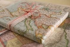map gift wrap - I did this years ago with a gift for my father-in-law and made a pom pom out of another map!  Cute