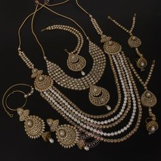Our MANSI NECKLACE + EARRINGS + MATHAPATTI + NOSE RING + BRACELET by Indiatrend. Shop Now at WWW.INDIATRENDSHOP.COM