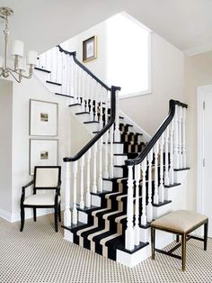 5 Ways to Dress Wood Stairs Dramatic. If you're looking to make a statement, a wide striped runner will do the trick. This eye-catching pattern enhances the dramatic contrast between the black and white tones present in this entry.