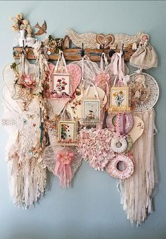 Shabby Chic Shelf and Hooks Overflowing with Flowers, hearts, wings, and birds. Vintage living