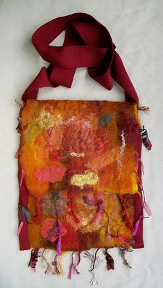 How to make a wet felted bag using a resist and the textured felt method. Sorry the photos aren't great, it's been nice and cloudy here, but not great for photos, so I had to rely on the flash.