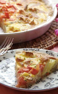 Tarte aux pommes de terre, tomates et brie