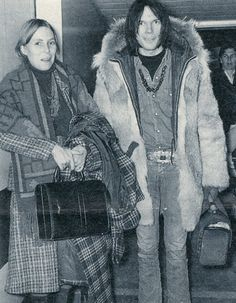 Neil Young & Joni Mitchell arriving at Heathrow Airport in December, 1969