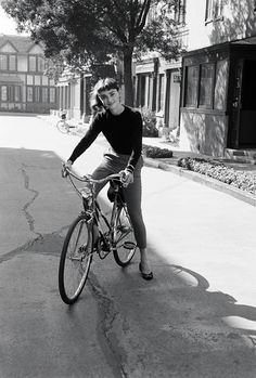 Audrey Hepburn on a bicycle.