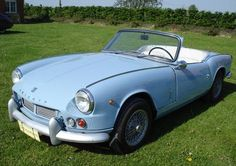 Triumph Spitfire. My sister's first car was just like this one. Cool.