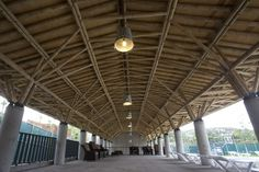 Image 11 of 50 from gallery of Sport City Oaxaca / Rootstudio + Arquitectos Artesanos. Photograph by Fidel Ugarte Bamboo Architecture, Vernacular Architecture, Coffee Colour, Canopy Tent, Facade, Brick, Sport, Chandelier, Earth
