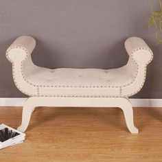 """Nailhead-trimmed bench with button-tufted seat.      Product: Bench    Construction Material: Wood and fabric    Color: Cream   Features: Nailhead trim  Dimensions: 28"""" H x 45"""" W x 17"""" D"""