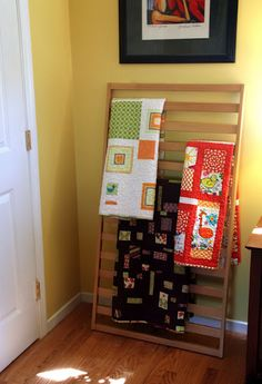 Repurposed Cribs for hubby quilts to hang on the wall