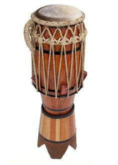 The Atabaque. There is only one in a roda and it is always  at the furthest left of the Batteria. It is a core instrument that keeps a beat  and follows the Berimbau's rhythm, whilst keeping its own.
