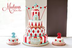 A sweet Circus themed cake for twins turning 2!  I loved making this cake and the matching smash cakes!  Photo credit: Kevin Paul Photography