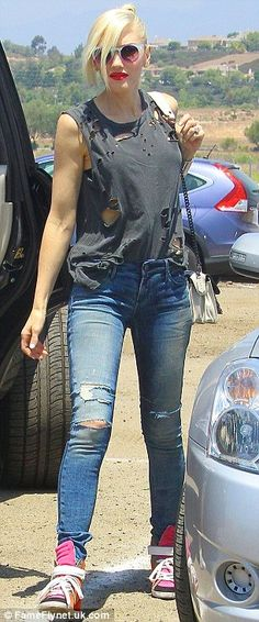 Hole-y moly! Gwen Stefani goes grunge in tattered top as she takes her sons on a…