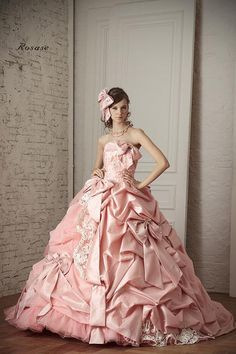 A PINK BALL GOWN WITH BOWS LACE AND SPARKLES. I JUST MELTED. I AM IN A PUDDLE ON THE FLOOR.