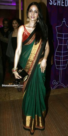 Sridevi in green silk sari with gold border and a red blouse. Designer Silk Sarees, Indian Designer Wear, Fancy Sarees, Party Wear Sarees, Trendy Sarees, Saree Blouse Patterns, Saree Blouse Designs, Saree Dress, Red Blouse Saree