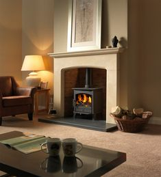 Nothing makes a room feel more cozy than a fireplace. Whether it's modern, traditional, farmhouse, or something altogether different, a living room that has a fireplace just feels more welcoming than one that doesn't. Log Burner Living Room, Living Room With Fireplace, Home Living Room, Cottage Fireplace, Farmhouse Fireplace, Wood Burner Fireplace, Limestone Fireplace, Brick Fireplace, Hanging Fireplace
