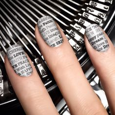 Buy 'em from Sephora, or do it on the cheap! Apply basecoat(s), wait for it to dry, dip your nails in water or rubbing alcohol, press newsprint/almost anything with text against the nail (like you're applying a temporary tattoo), wait a few secons, remove, reveal, seal with topcoat. voila!