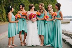 turquoise bridesmaids with pink and orange bouquets | Jamie Delaine Photography