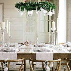 hang a wreath over the dining table and hang ornaments from it.  - Christmas Dining Room Decorating Ideas, Decor for a Holiday Dinner Party