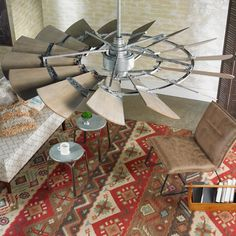 """60"""" Outdoor Rustic Windmill Ceiling Fan This stunning Damp location rated rustic ceiling fan utilizes fifteen dramatically tilted blades channeling the design of a windmill. Available in Oiled Bronze with Weathered Oak look Aluminum Blades or Galvanized with Weathered Oak look Aluminum Blades. 6 speeds-reversible with wall control. Supplied with wall mount remote control."""