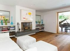 Simple shelving on either side of the FRPL; Pamela Anderson's Malibu Beach House listing (19)