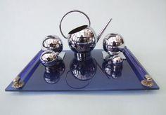 modern silver tea set with cobalt tray