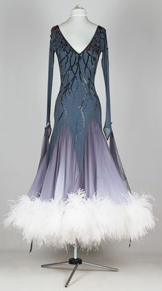 This is a pretty dress. However, I am not a fan of gray for Latin or Ballroom because it does not show well on the brown floors.