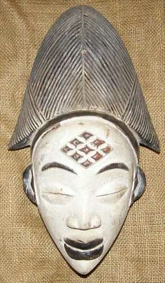 Punu masks represent the idealised beauty of Punu women, and should only be carved by Punu men. The elaborate Punu hairstyles suggest that the wearer is wealthy as her hair has not been flattened by the need to carry goods. Sometimes Punu masks are painted white with kaolin clay to represent the spirits of dead ancestors during funerals.