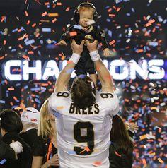 f19750da2 Super Bowl XLIV Champions, the New Orleans Saints! Drew Brees and son Baylen