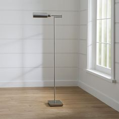 Shop Adams Nickel Pharmacy Floor Lamp.  Updated pharmacy floor lamp in modern metallics aims to please with a fully adjustable arm to direct light where it's needed and a flat base to tuck up under a chair or sofa.