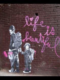 Charlie Chaplin and Kid, by Mr. Brainwash, street art, graffiti.
