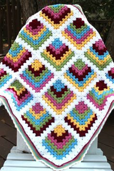 I saw this blanket at the Crochet Again blog, and there was never any doubt that I would make one. I just loved her take on the traditional granny square and, as luck would have it, the yarn color…