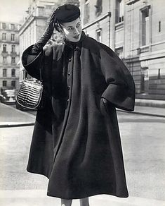 1951 Model is wearing Balenciaga's wool winter coat inspired by the clergy, photo by Philippe Pottier