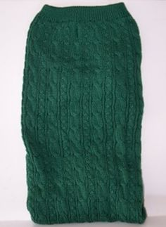 Green long sleeve cable-knit sweater.