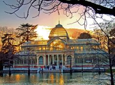 Madrid.  Palazio de Cristal in the Retiro.  I love being in this building.  Even the stone work on the outside is pretty.  I love spending time with the little ducks sitting on the stairs that sink into the water.