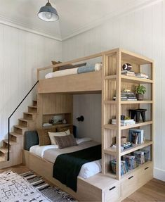 This bunk bed by Amber Lewis creates so much storage space! Created for her latest project, this bunk bed was combined with a bookshelf and drawers. Plus, unlike typical bunk beds, this one has a small set of stairs that lead to the upper level. Camper Bunk Beds, Bunk Bed Rooms, Bed For Girls Room, Bunk Beds For Girls Room, Loft Bunk Beds, Bunk Beds Built In, Bunk Bed With Desk, Bunk Bed Plans, Modern Bunk Beds