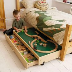 Play table in under-bed storage. and the appliqued dinosaur bed is radical awesome. Train Table, Under Bed, Bed With Drawers Under, Bed Storage, Storage Ideas, Table Storage, Playroom Storage, Storage Solutions, Bedroom Storage